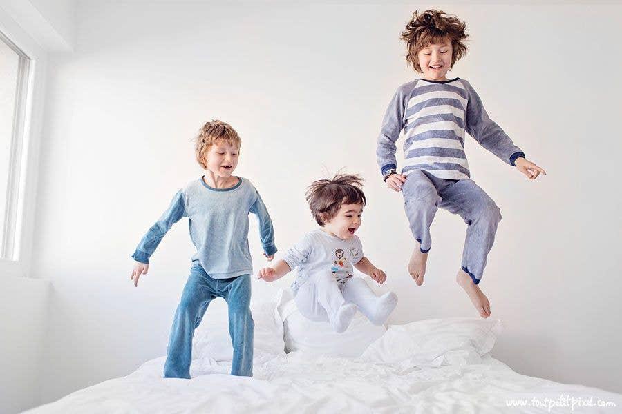 kids jumping on a mattress