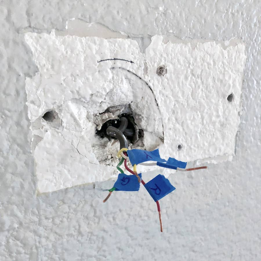 Remove your old thermostat and label the wires