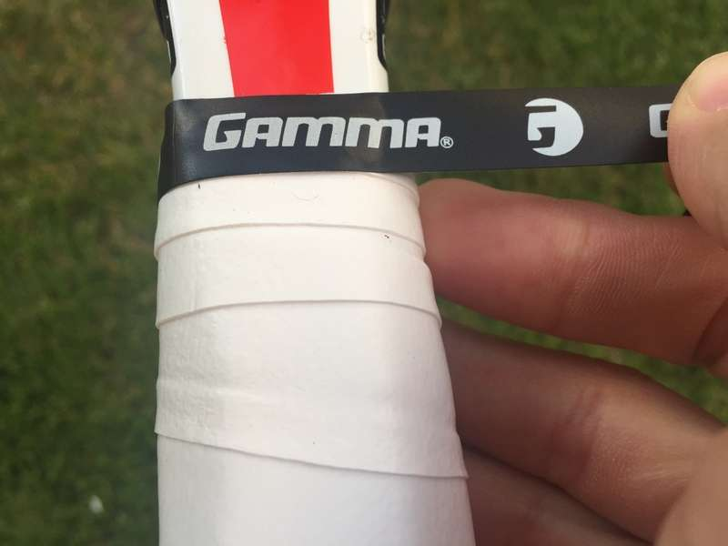 Place tape on the end to secure the overgrip in place