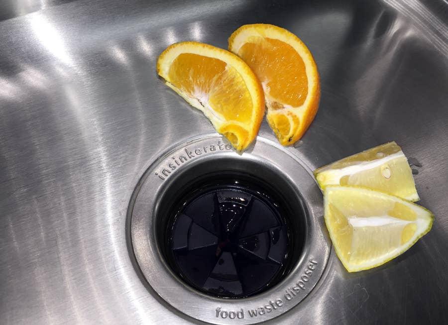 freshen garbage disposal with lemons