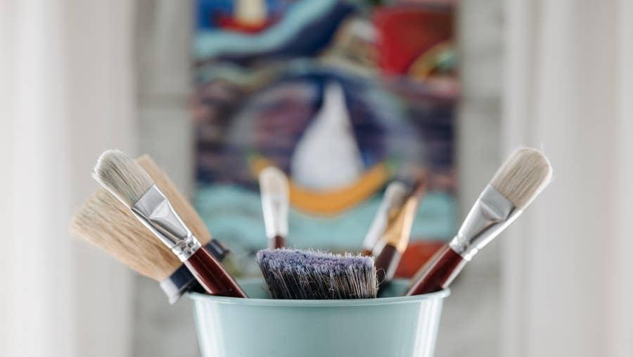 Drying paintbrushes.