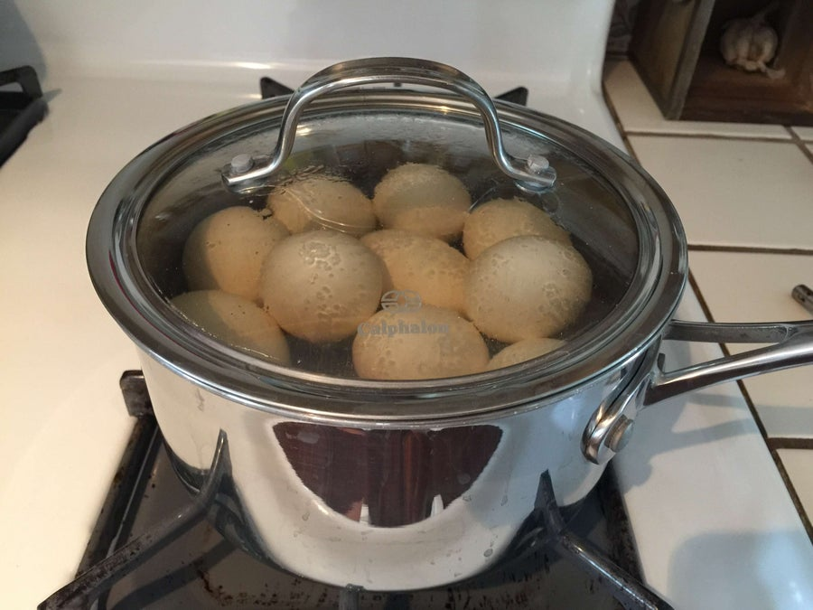 Eggs simmering in a closed pot with the heat turned off
