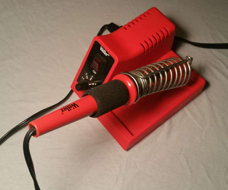 Heat the soldering iron