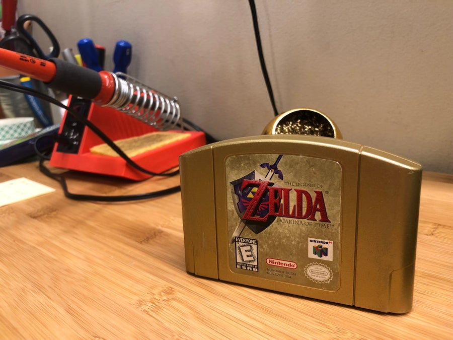 Zelda Ocarina of Time N64 game in front of soldering station