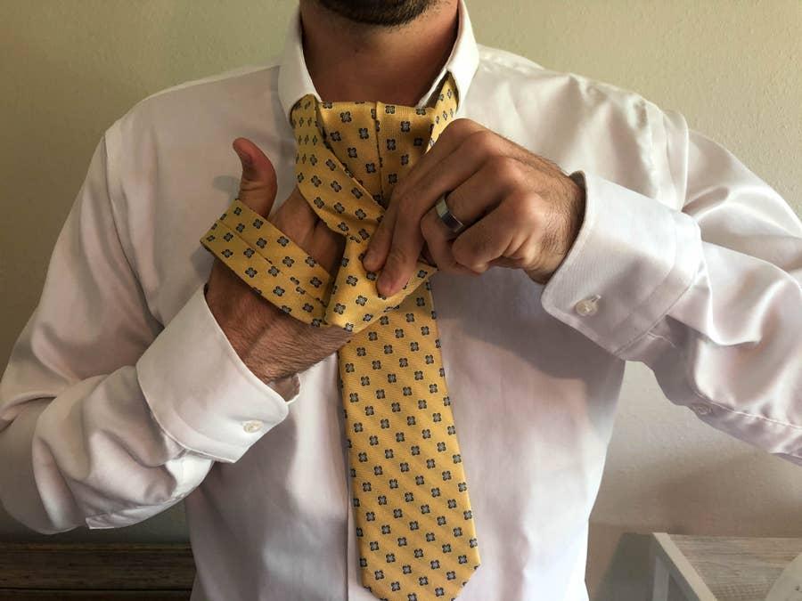 Man Finishing Tying His Tie