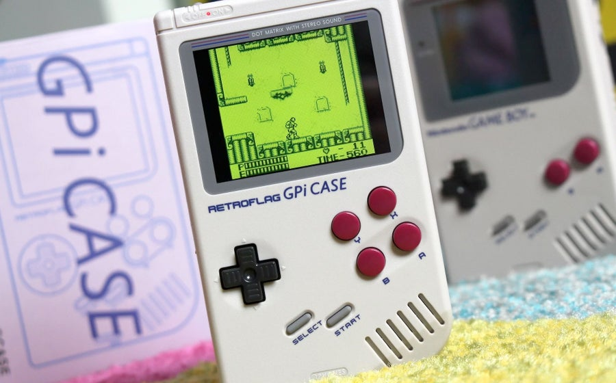 The Retroflag GPi in front of an original Game Boy