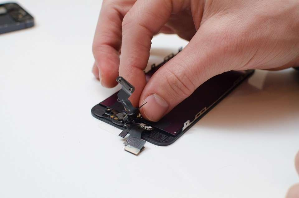 Replace the camera assembly on the new screen