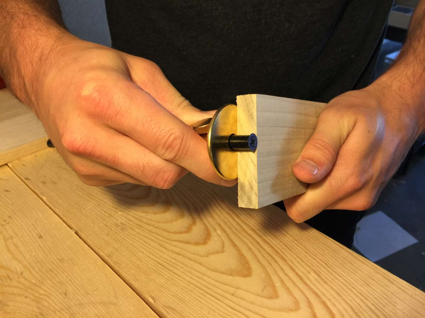 Use your marking gauge to measure the depth of the pin board