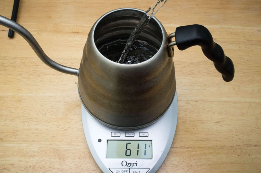 Filling a gooseneck kettle with water