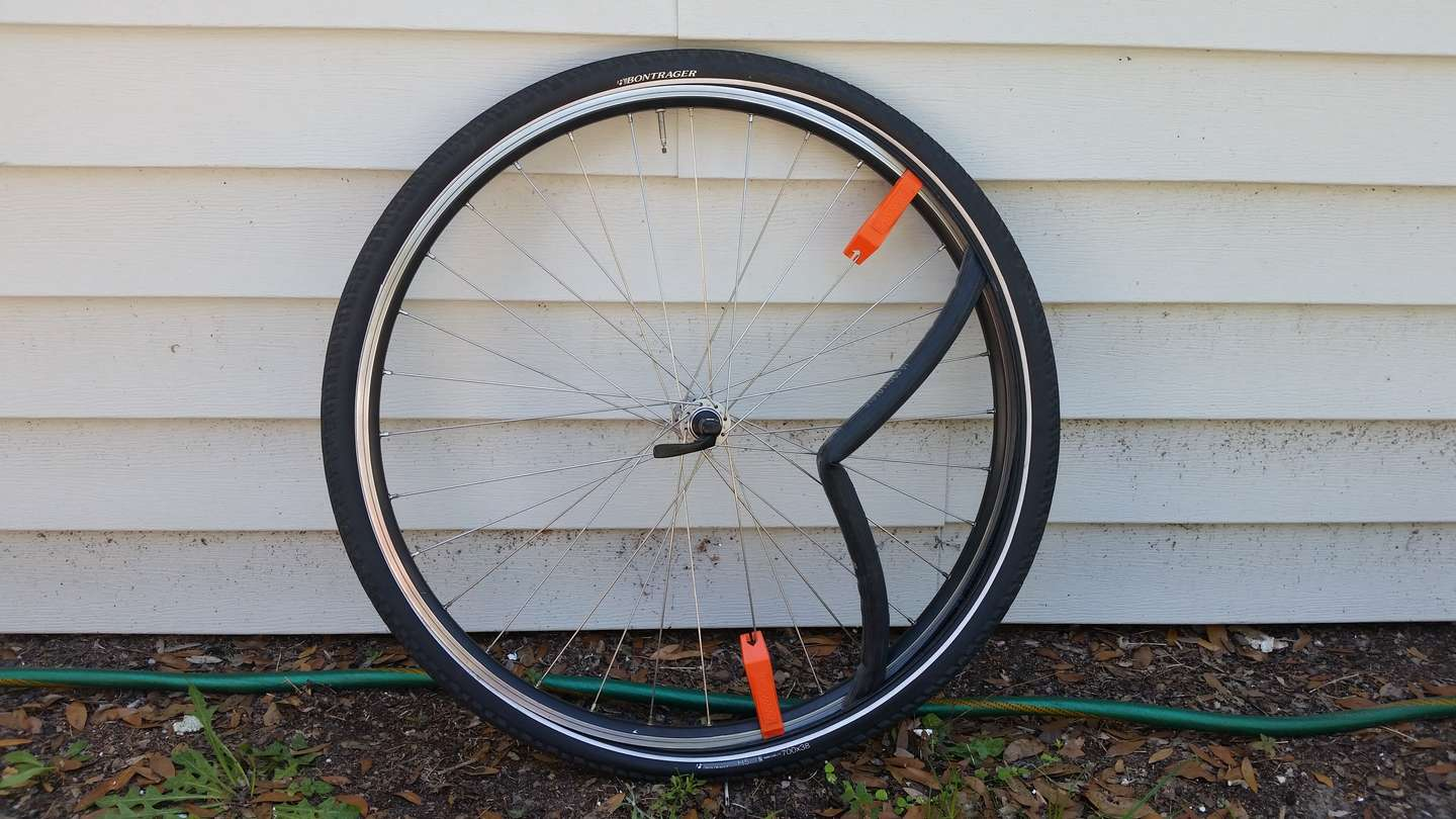 A wheel with two tire levers in place