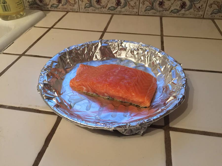 A raw salmon filet covered with olive oil