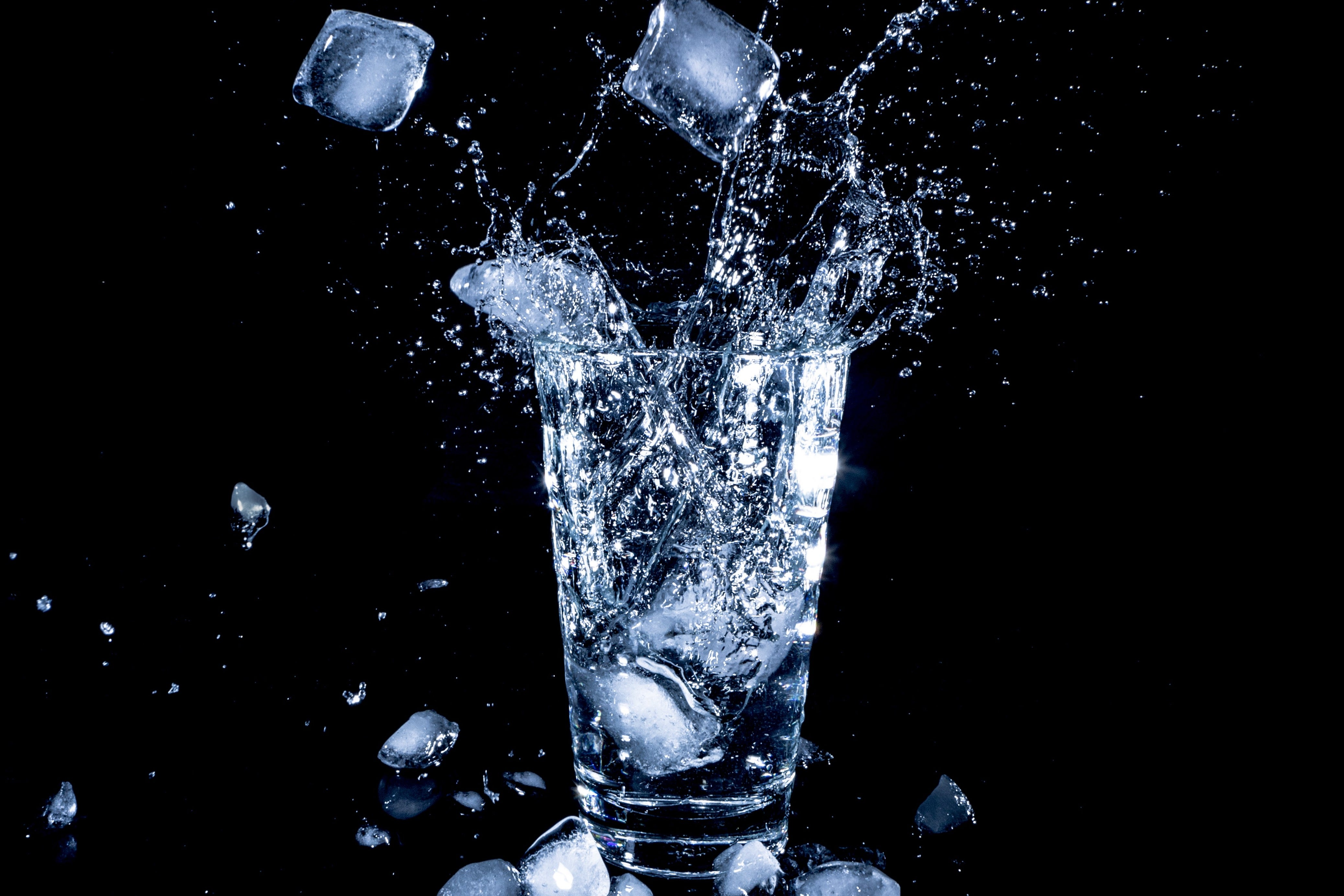 Ice falling into a glass