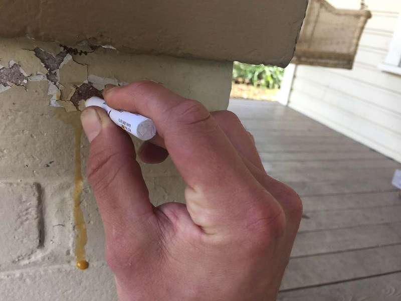 Rub the applicator on the scraped paint area