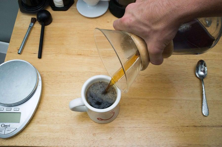 pouring chemex coffee into a mug