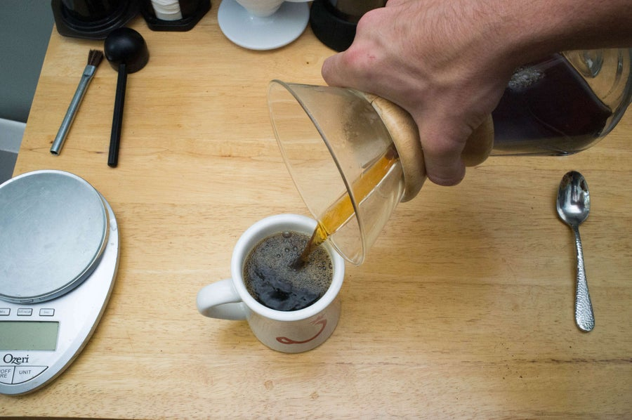pouring chemex coffee into a mug