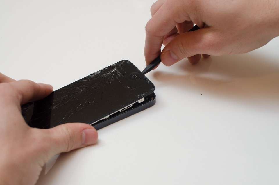 Using the black pry tool, pry the screen away from the phone