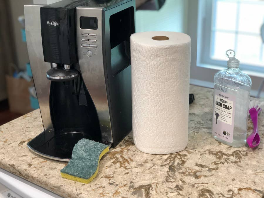 Coffee maker with sponge and paper towel