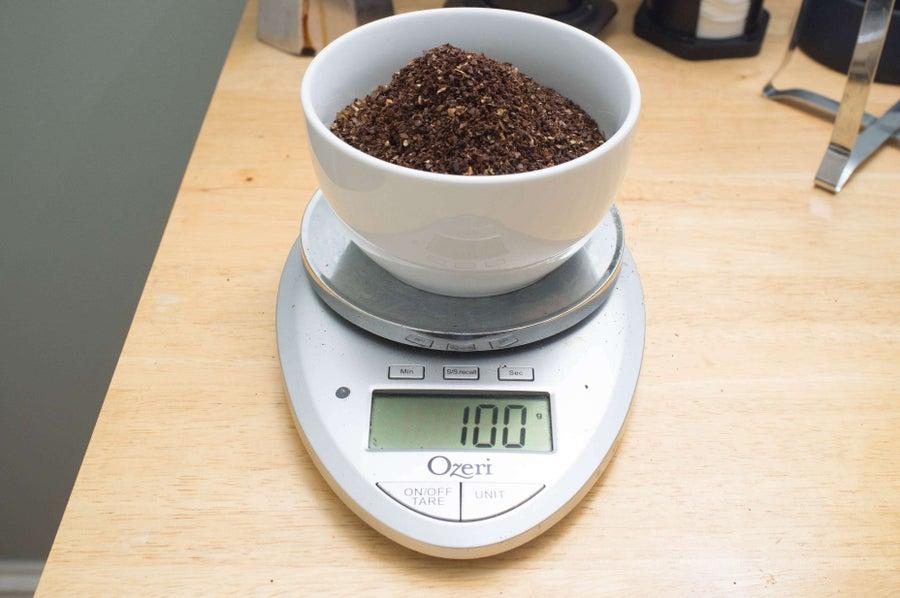 Weighing coffee in a bowl on a scale