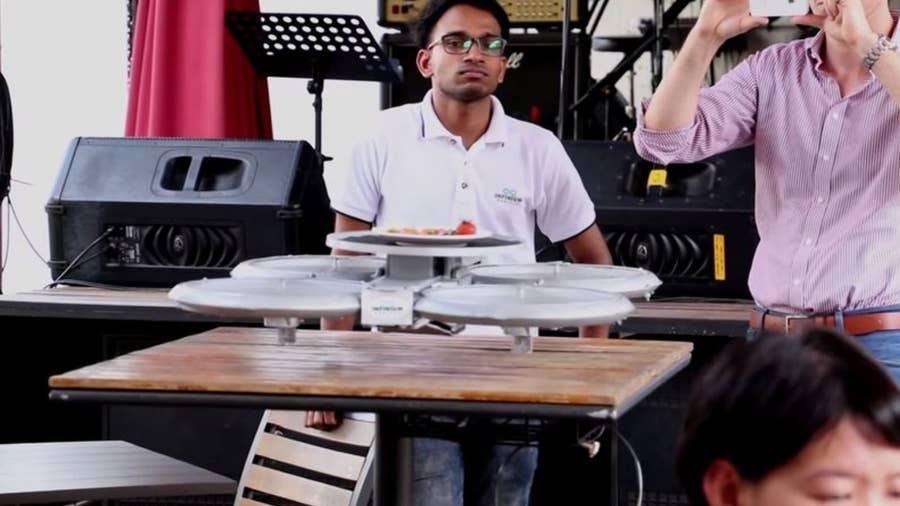 Infinium-Server drone robot in Singapore