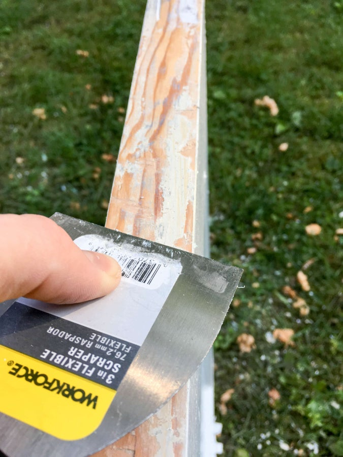 Scrape off all the paint from the outside edge (the edge closest to your door knob)