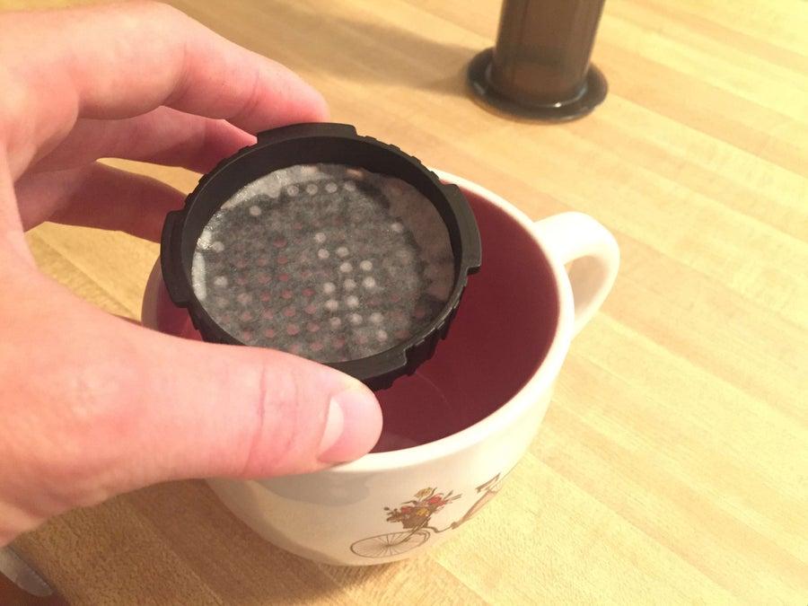 rinsing aeropress filter into cup