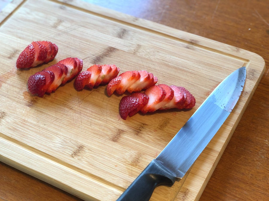 Sliced strawberries with knife