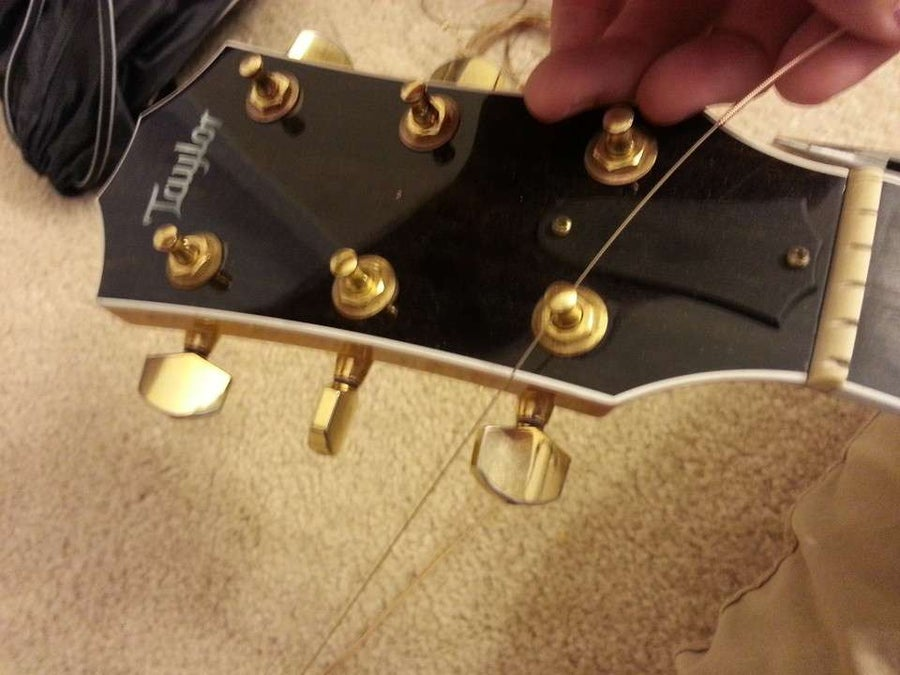 Place the other end of the string through the tuner hole
