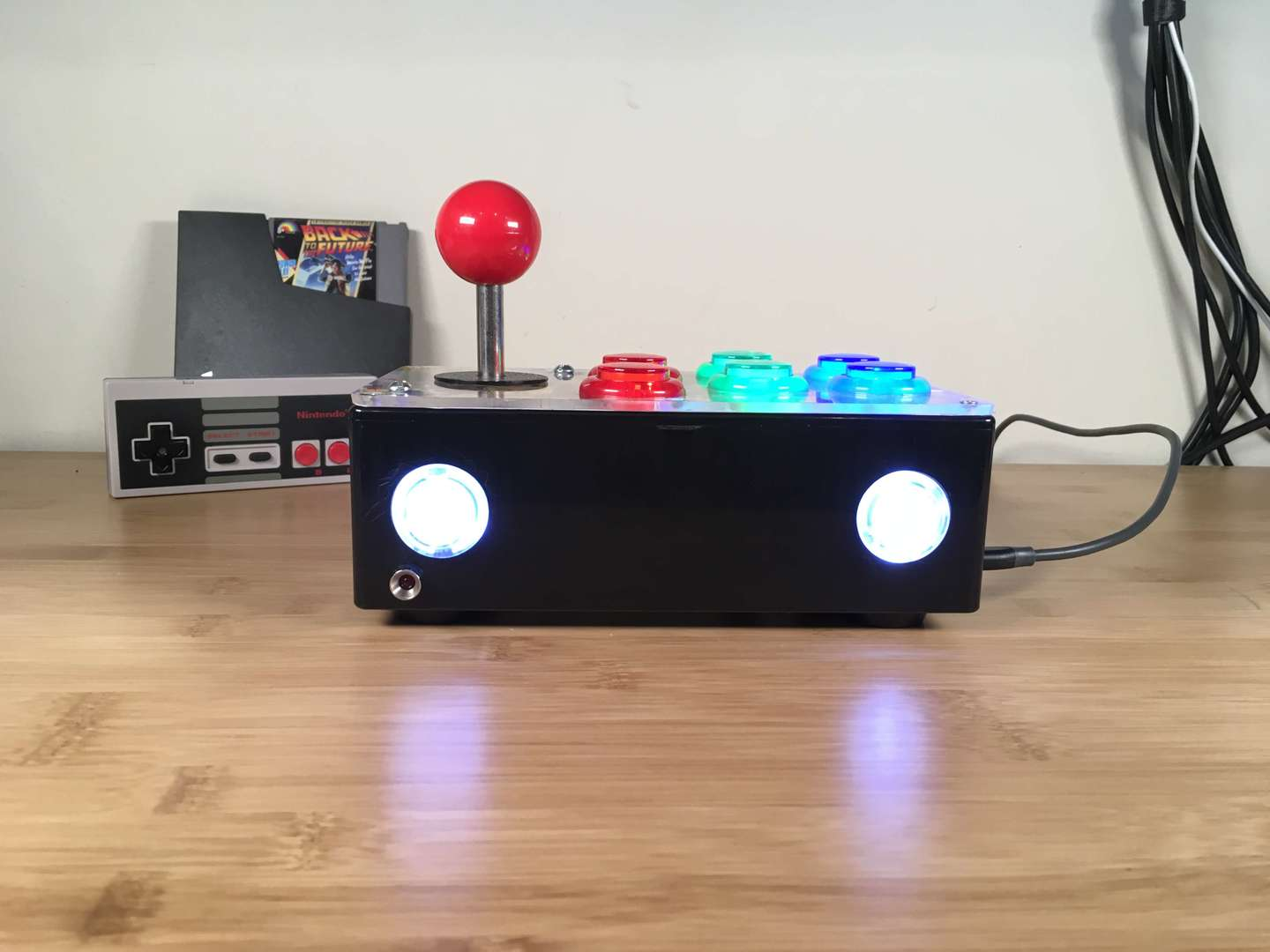 A Raspberry Pi DIY arcade joystick on a desk