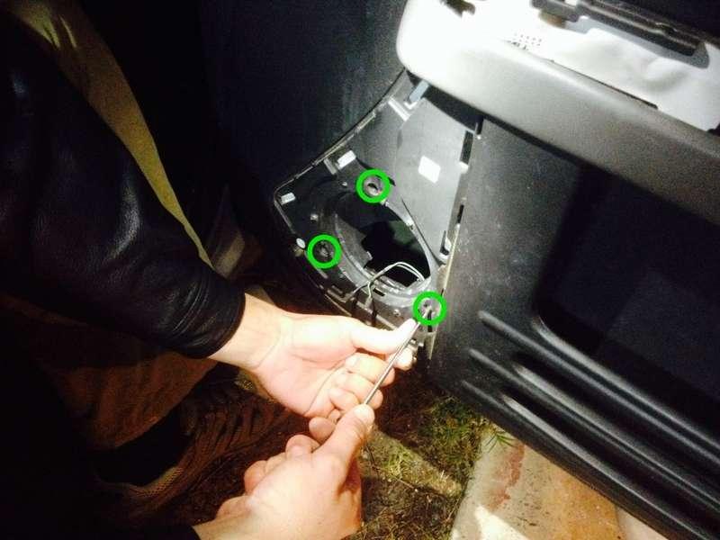 Remove the 4 door panel screws
