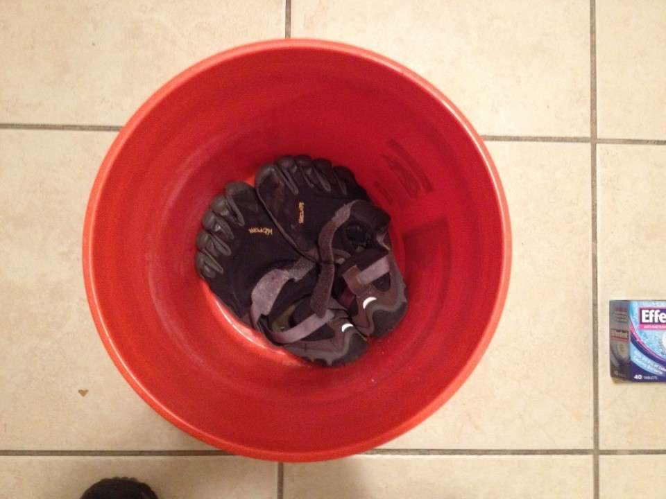 Place your toe shoes into a bucket