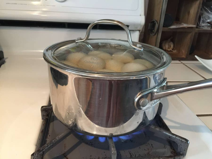 Eggs boiling in a pot with the lid closed