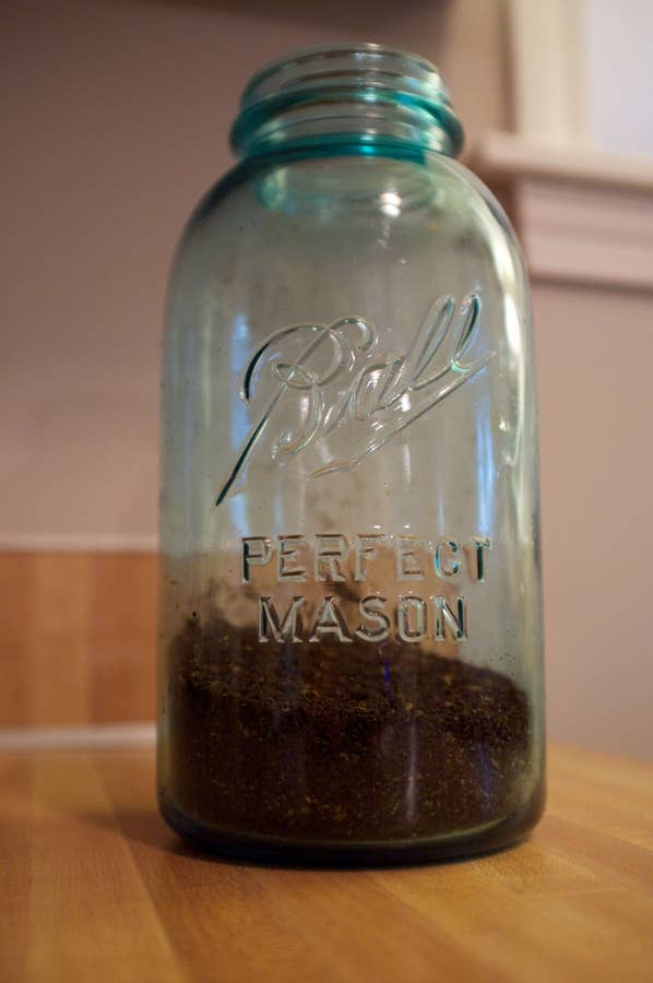 Coffee grounds in a mason jar