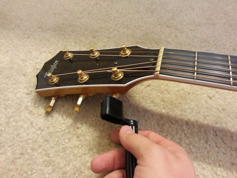 Unwind the string by turning the tuner counter-clockwise