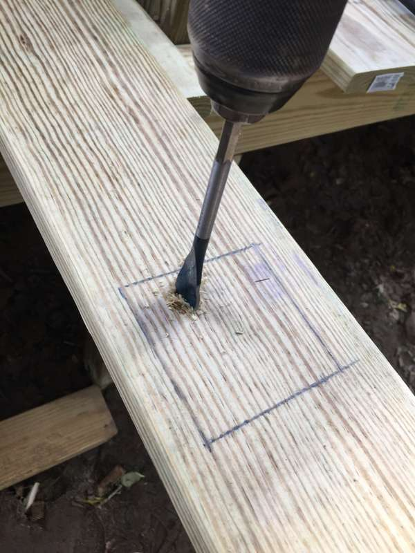 Drill a hole in one corner