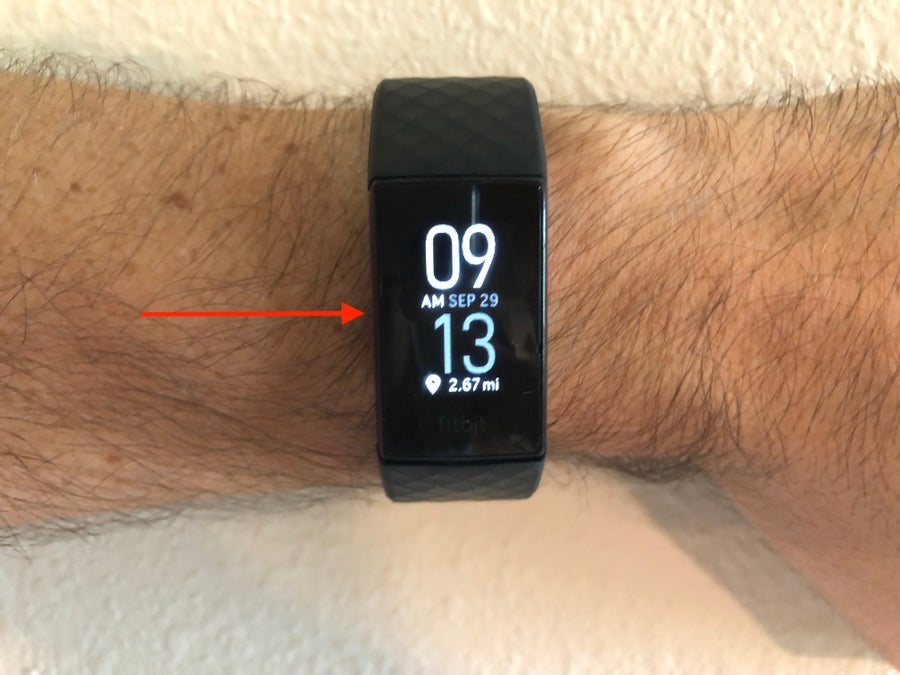 Fitbit Charge 4 with arrow to left button