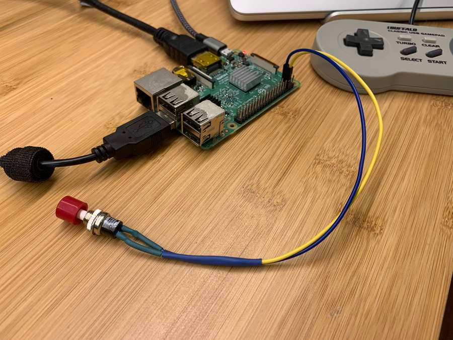 A Raspberry Pi power button connected to a Pi