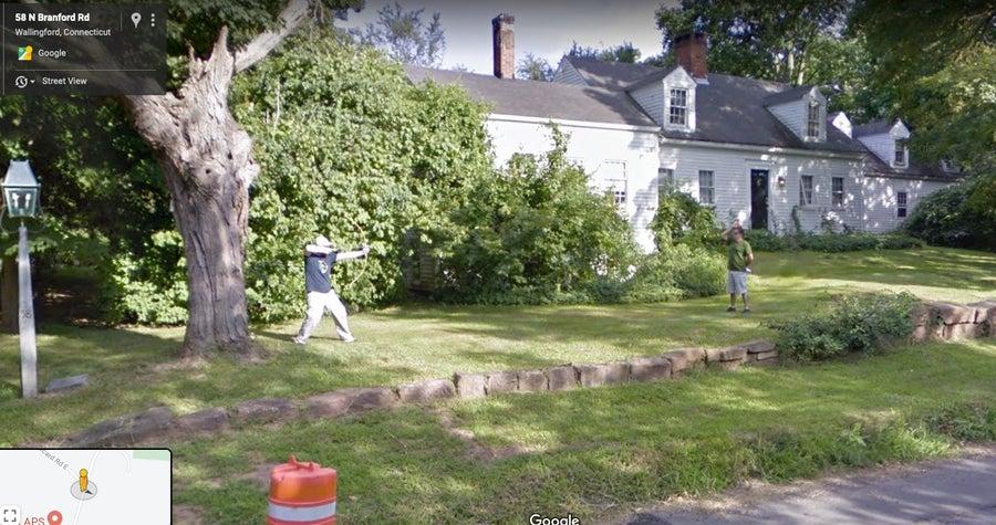 man shooting arrow google street images