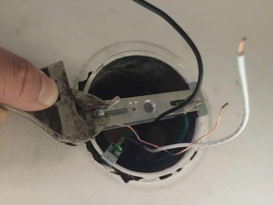 Attach the lamp bracket