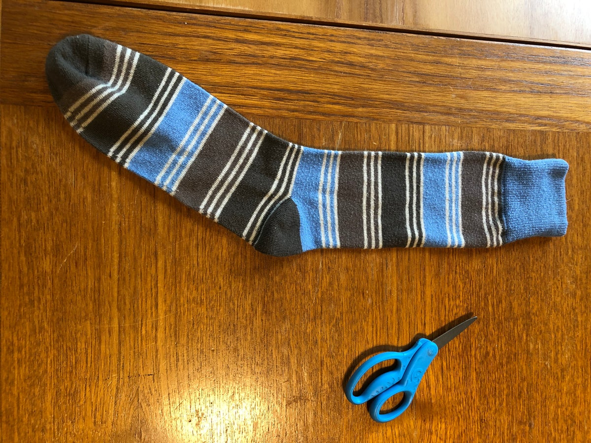 Blue and Brown Sock with Scissors