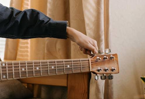 Tuning guitar.