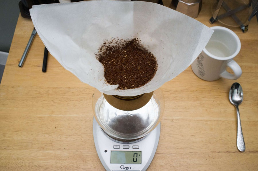 top down view of a chemex coffee maker filled with dry coffee grounds